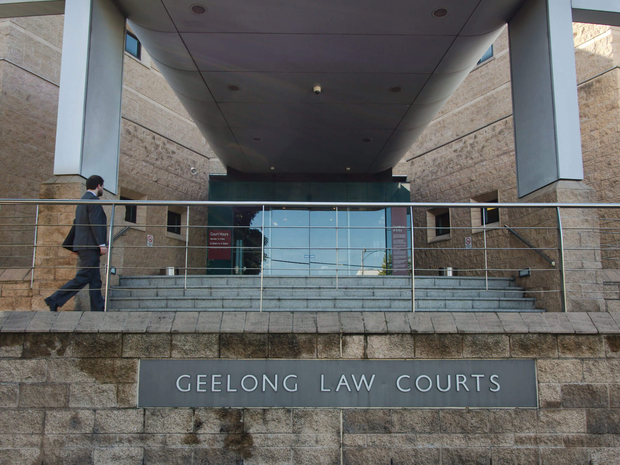 Court building exterior, awaiting personal safety intervention order hearing